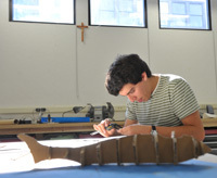 Industrial design student in new model shop