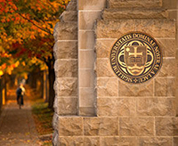 The University seal as seen from Notre Dame Avenue
