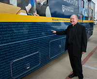 Father Tim Scully outside the ACE bus