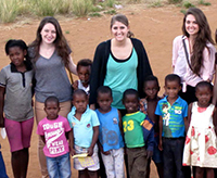 Design students Sara Kolettis, Laura Straccia, and Maria Massa in South Africa