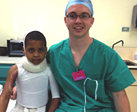 Farrell Sheehan with a burn patient in the Dominican Republic