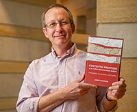 "Associate Professor Asher Kaufman holds his new book, ""Contested Frontiers in the Syria-Lebanon-Israel Region: Cartography, Sovereignty and Conflict"""