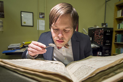 David Gura examines manuscript