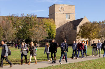 Students walk near O'Shaughnessy dressed for Fall