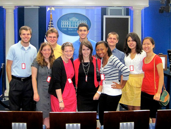 A group of Notre Dame students stand in the White House briefing room