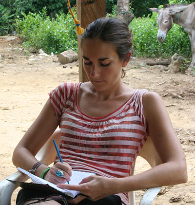 Angie Lederach writing field notes in Alta Montaña, Colombia