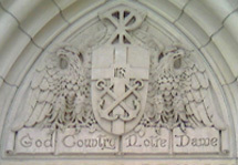 """God, Country, Notre Dame"" detail above Basilica door"