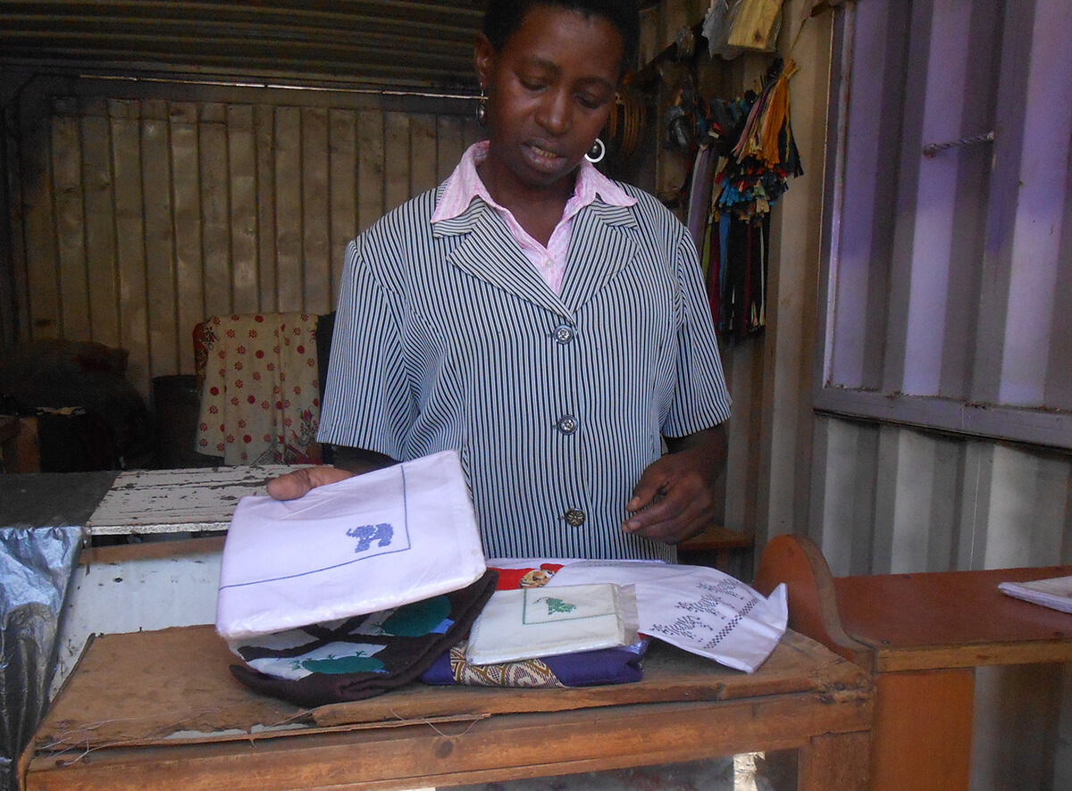 A Nairobi business owner folds garments