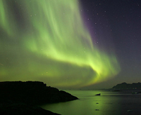 The northern lights over Kulusuk, a small island on the east coast of Greenland. Photo courtesy of Nick Russill, Flickr.