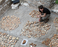 Suzanna Pratt recording the pottery finds at Butrint, Albania