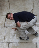 Wesley Wood touches the forum pavement in Butrint, Albania