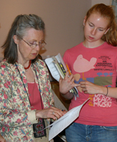 Diana Matthias and Lea Malewitz help prepare the DIGNITY exhibit