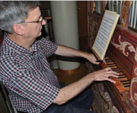 Music Professor Craig Cramer plays a 17th-century Italian chamber organ recently installed in the Reyes Organ and Choral Hall