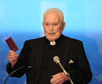Father Hesburgh holds Irish passport