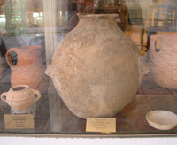 Early Bronze Age pottery vessels, likely from Fifa or one of the neighboring cemeteries, for sale in a registered antiquities shop in Jerusalem (photograph by Morag Kersel)