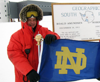 American Studies alumnus Michael Zernick '83, proudly holds a University of Notre Dame flag at the South Pole