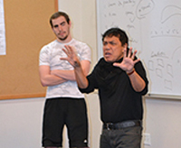 Theater professor Anton Juan works with students in a class on performance analysis