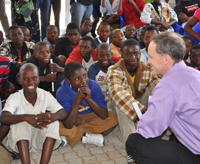 Ambassador Griffiths talking to boys at a circumcision clinic