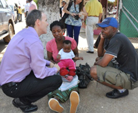 Ambassador Griffiths meets baby Anna and her family in Xai Xai, Mozambique