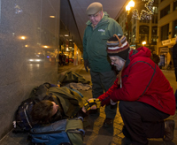 Notre Dame alumnus Jim Greene '85 (in red) and Boston Mayor Thomas Menino help the homeless