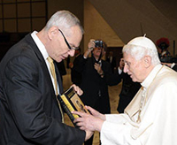 John Cavadini presents Pope Benedict XVI with a festschrift from the University of Notre Dame