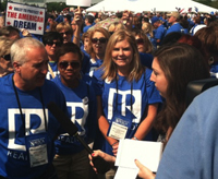 "Patricia Harte, far right, interviews realtors at the ""Rally for the American Dream"" in front of the Washington Monument"