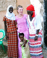 Peace Corps volunteer Lisa Floran ('09 PLS) with her host family in Senegal