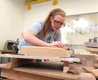 A student in the Reilly Arts and Letters/Engineering Dual Degree Program, notre Dame senior Breanna Stachowski works on a prototype of her design